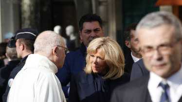French First Lady Brigitte Macron, centre, arrives to attend a mass, as part of the Holy Week, at the Saint Sulpice Church in Paris.