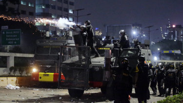 Police fired tear gas and water cannons on Tuesday to disperse thousands of rock-throwing students in Jakarta on Tuesday.