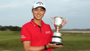 Trophy moment: Min Woo Lee after winning the Vic Open at 13th Beach Golf Club.
