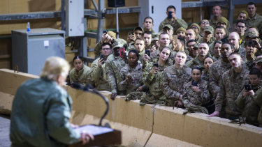 President Trump addresses troops during a visit to al-Asad Air Base in Iraq in December last year.