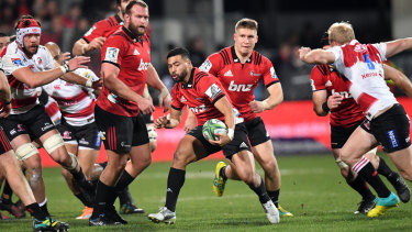 Linchpin: Richie Mo'unga splits the Lions defence during the Super Rugby final at AMI Stadium.