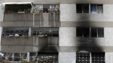 Signs of smoke cover the apartment complex where an allegedly armed drone crashed, causing a fire, in Caracas.