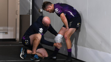 Cameron Munster hobbles out of the Storm's win over Parramatta on Saturday night.