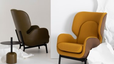 """The""""Aviso"""" armchair with a leather and fabric upholstered seat and matching pedestal table."""