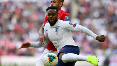 Danny Rose of England wraps his boot around the ball against Bulgaria at Wembley.