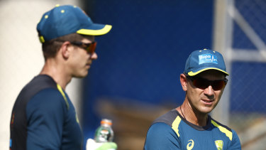 Justin Langer (right) with skipper Tim Paine.