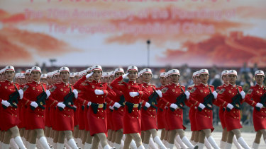 Chinese female militia members march at a parade to commemorate the 70th anniversary of the founding of Communist China in Beijing.