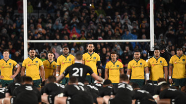 Wallabies players look on to the New Zealand All Blacks Haka during the Bledisloe Cup match between the New Zealand All Blacks and the Australian Wallabies at Eden Park in Auckland, New Zealand, Saturday, August 17, 2019. (AAP Image/Dave Hunt)
