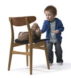 Patricia Piccinini's Doubting Thomas. Silicone fiberglass, human hair, clothing, chair, 100.0 x 83.0 x 90.0cm. McClelland Gallery+Sculpture Park. Purchased 2010.