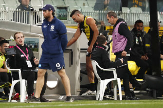 Shane Edwards leaves the field injured in the loss to Geelong.