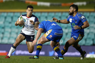 Matt Toomua of the Rebels on the run  on Friday night.