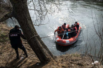 Refugees and migrants are rescued from an island in the middle of the Evros river on Sunday. They had been stuck there for two days after trying to cross from Turkey to Greece.