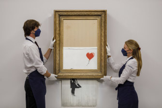 """Banksy's """"Love is the Bin"""" before auction."""