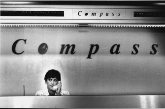 Julie Merle at the Compass counter in 1993.