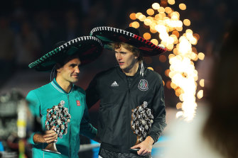 Roger Federer and Aexander Zverev chat during the post-match festivities in Mexico.