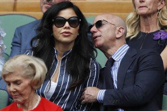 Jeff Bezos with Lauren Sanchez at Wimbledon in July last year.