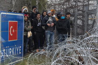 Refugees and migrants gather at Pazarkule border as they attempt to enter Greece from Turkey.