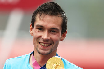 Slovenian Primoz Roglic with his gold medal.