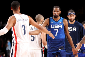 Team USA's Kevin Durant shakes hands with French opponents.