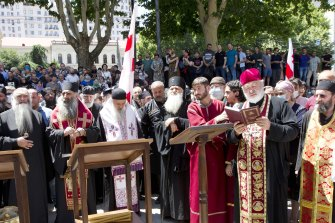 Georgian Orthodox priests who opposed the march lead prayers after blocking the capital's main avenue to an LGBT march.