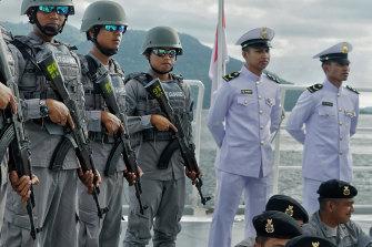Indonesian coast guards prepare to patrol the North Natuna Sea.