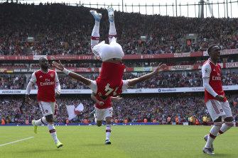 Arsenal's Pierre-Emerick Aubameyang, centre, celebrates a goal.