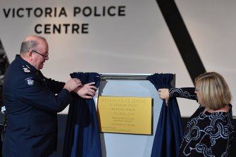 Victoria Police's outgoing Chief Commissioner Graham Ashton and Police Minister Lisa Neville at the official opening of the new police HQ in Spencer Street.