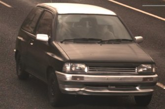 Police are searching for the driver of a black hatchback, pictured, who hit a police officer in Flynn on Monday afternoon.