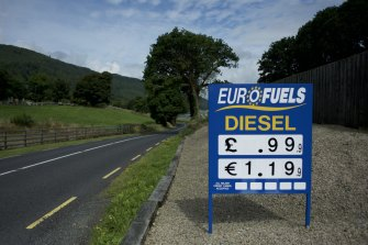 A petrol station sign with prices in euros and pounds, near the border between the Republic of Ireland and Northern Ireland in Omeath.