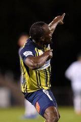 Trademark celebration: Usain Bolt enjoys his first strike.