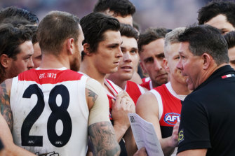 Saints interim coach Brett Ratten with the players at three-quarter time on Saturday.