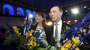Chairman of The Finns Party Jussi Halla-aho, right, attends a post-election party on Sunday.