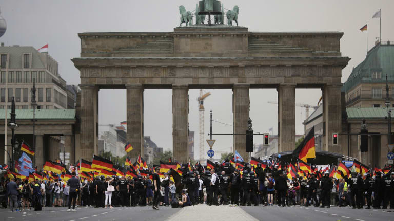 AfD supporters wave flags in front of the Brandenburg Gate in Berlin, Germany, in  May.