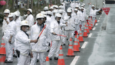 Police officers control traffic prior to the two-day world leaders' summit in Osaka.