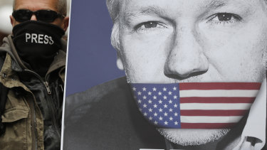 A supporter holds a poster of Julian Assange during a demonstration in London.