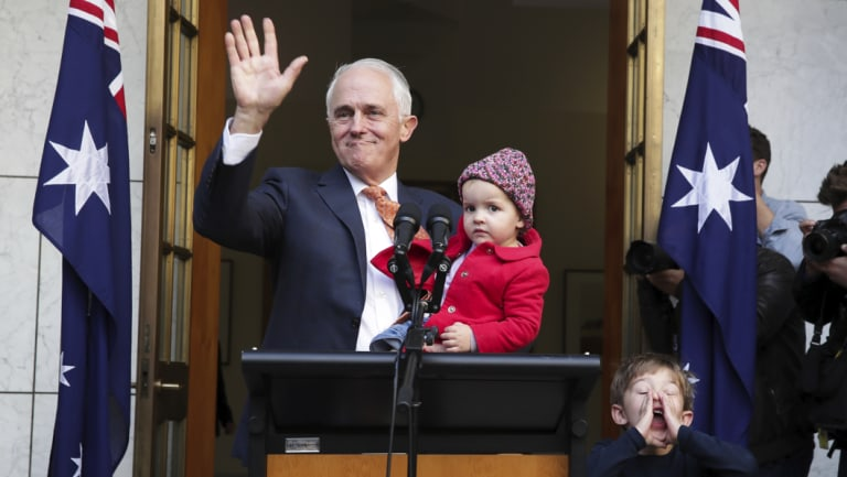 Malcolm Turnbull waves goodbye at the end of his final press conference as prime minister, surrounded by granddaughter Alice and grandson Jack.