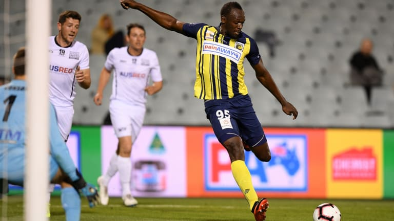 Long shot: Usain Bolt takes a pop at goal against Macarthur South West United at Campbelltown Stadium on Friday.