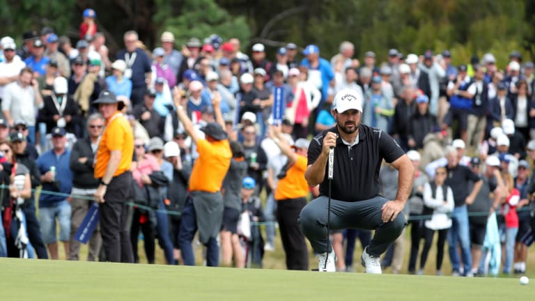 Lining up: Roberto Diaz of Mexico ponders a putt on the 17th in front of a large gallery.