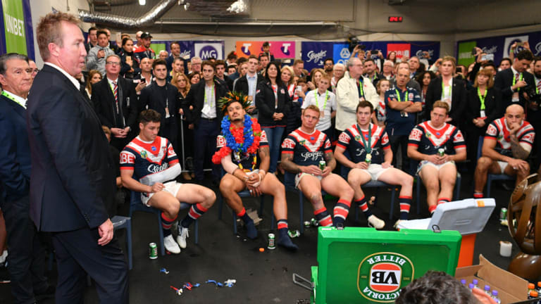 Centre of attention: Trent Robinson talks the talk after the Roosters walked the walk in the grand final.