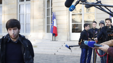 Jason Herbert, a member of the so-called yellow jackets movement, leaves the Prime Minister's office in Paris.