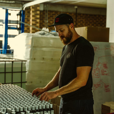 Luke Swenson inspects his inventory at The Bearded Chap's Queensland factory.