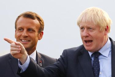 French President Emmanuel Macron, left, welcomes Britain's Prime Minister Boris Johnson at the Biarritz lighthouse, southwestern France, at G7.