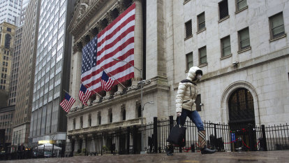 Wall Street down on flight from techs; move to value limits losses