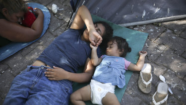 US-bound migrants rest at a camp near an immigration centre in Matamoros, Mexico.
