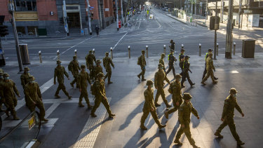 Australian Defence Force personnel and police at Southern Cross Station in Melbourne on Sunday, ready to enforce Melbourne's strict new lockdown rules.