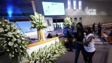 Mourners pass by the casket of George Floyd during a public visitation for Floyd at the Fountain of Praise church on Monday.
