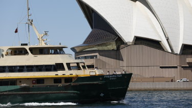 A Freshwater ferry passes the Sydney Opera House.