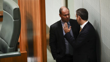 Environment and Energy Minister Josh Frydenberg and Labor finance spokesman Jim Chalmers chat during Question Time.