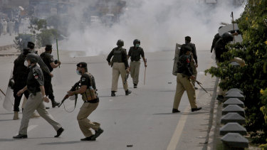 Police fire tear gas to disperse angry supporters of Tehreek-e-Labiak Pakistan, a radical Islamist political party, protesting against the arrest of their party leader, Saad Rizvi, in Peshawar, Pakistan.