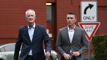 One Nation party officials Steve Dickson (left) and James Ashby front the media in Brisbane.